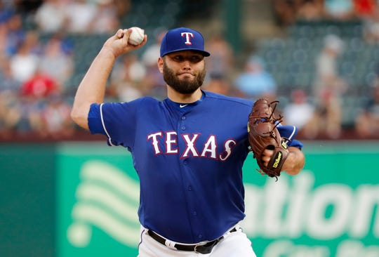 Texas Rangers starting pitcher Lance Lynn throws to a Detroit Tigers batter during the first inning of a baseball game in Arlington, Texas, Friday, Aug. 2, 2019. (AP Photo/Tony Gutierrez)