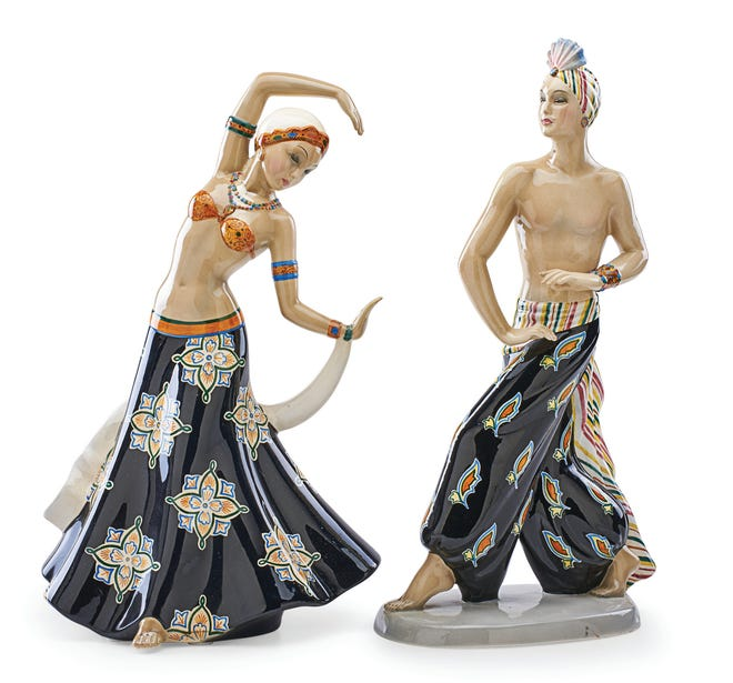 "This pair of dancers titled ""Cavaliere Indiano and Danzatrice Indiana"" were made in the 1930s in Turin, Italy. They have the incised mark ""Cia Manna."" The pair was estimated at $800 to $1,200 but did not sell."