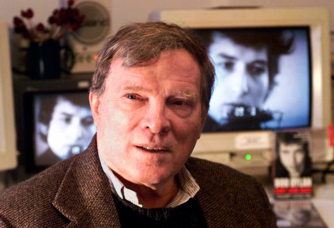In this Jan. 27, 2000 file photo, documentary filmmaker D.A. Pennebaker is flanked by 35-year-old images of Bob Dylan as Pennebaker sits in his New York editing suite. Oscar-winning documentary maker Pennebaker has died at the age of 94.