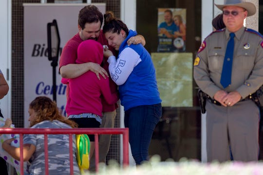 People hug outside of MacArthur School Elementary-Intermediate School on Aug. 4, 2019, in El Paso, Texas. A family reunification site has been designated at the site for friends and families missing loved ones after the shooting at the Cielo Vista Walmart.