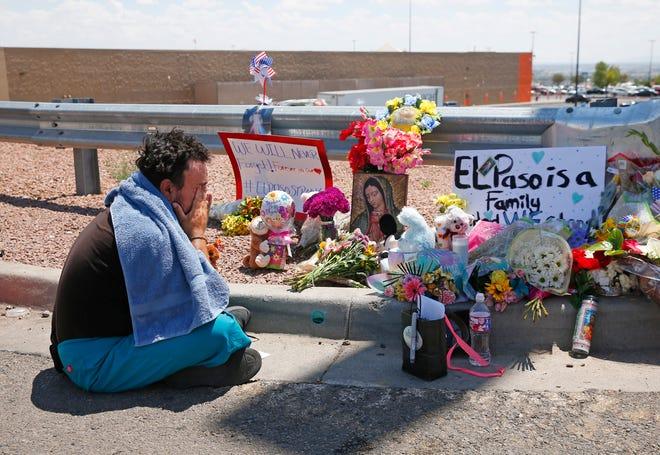 Felipe Avila mourns outside Walmart in El Paso on Aug. 4, 2019.