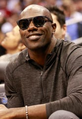 Former NFL player Terrell Owens smiles during the first half of the games between the Orlando Magic and Memphis Grizzlies at Amway Center.