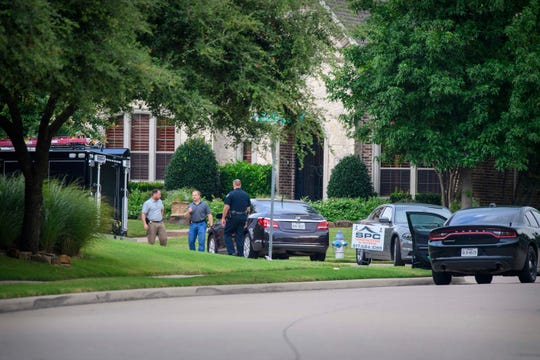 A view of members of the Allen police department and the FBI as they gather evidence from the home of Patrick Crusius in Allen, Texas. Crusius is the named suspect who allegedly killed 20 people in a mass shooting at a Walmart shopping center in El Paso, Texas.  Jerome Miron/USA TODAY