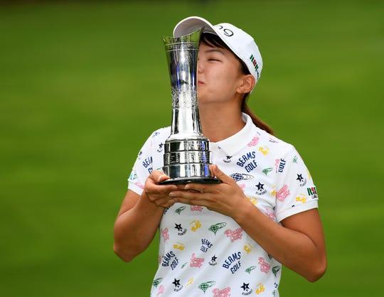 Hinako Shibuno celebrates after winning the AIG Women's British Open.