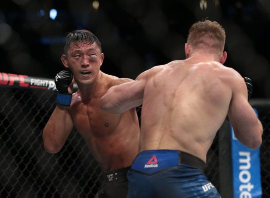 Dong Hyun Ma, left, fights Knoxville's Scott Holtzman during UFC Fight Night at Prudential Center in Newark, New Jersey.