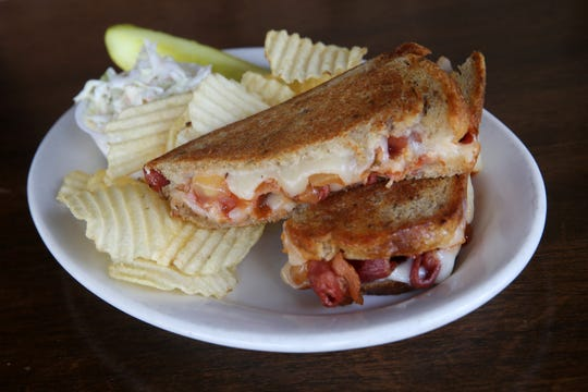 Grilled Cheese of the Week, Monterey Jack cheese, bacon and sweet Vidalia onion sauce on rye bread, at Nip-n-Tuck Bar & Grill, a beloved Long Branch-based bar, grill and packaged goods establishment that's been in business for over 55 years, in Long Branch, NJ Monday August 5, 2019.