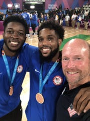 Myles Cale, Myles Powell and Kevin Willard after the medal ceremony.