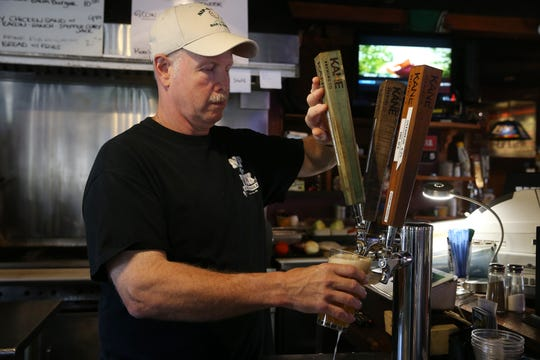 Bob Burtchaell, co-owner, pours a beer at Nip-N-Tuck Bar & Grill, a beloved Long Branch-based bar, grill and packaged goods establishment that's been in business for over 55 years, in Long Branch, NJ Monday August 5, 2019.