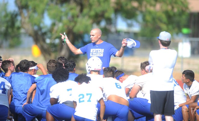 Winters football coach Matt McCarty addresses the Blizzards following the first day of football practice Monday, Aug. 5, 2019, at Winters' practice field.