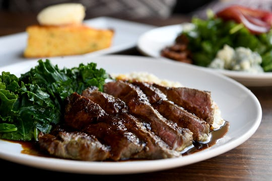 The Sous Vide Lamb at The Blackbird in downtown Asheville is served with creamy grits, sauteed seasonal greens, and an apple cider sorghum gastrique.