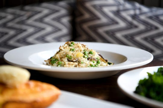 The Truffle Mushroom Risotto at The Blackbird in downtown Asheville features arborio risotto, local mushrooms, seasonal vegetables, hemp milk, nutritional yeast and cauliflower puree. It is listed under the vegan section of their menu.
