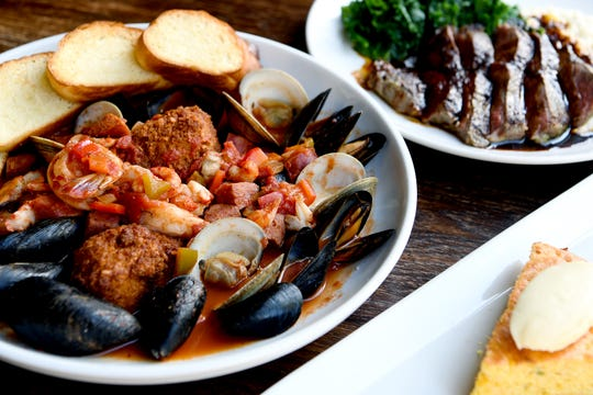 The Fruits of the Sea at The Blackbird in downtown Asheville is PEI mussels, little neck clams, garlic, and spiced white wine tomato sauce, and is served with grilled bread.