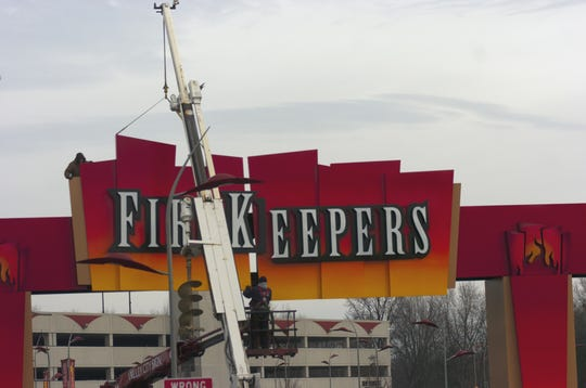 In this 2009 photo, a crew installs signage on an entrance and exit archway at FireKeepers Casino.