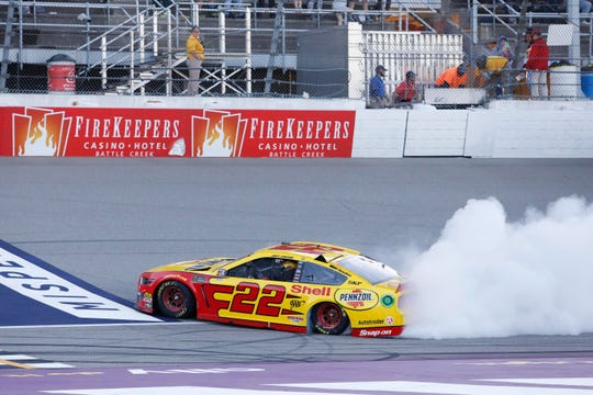 Monster Energy NASCAR Cup Series driver Joey Logano (22) performs a burnout after winning the FireKeepers Casino 400 at Michigan International Speedway on June 10, 2019 in Brooklyn, Michigan.