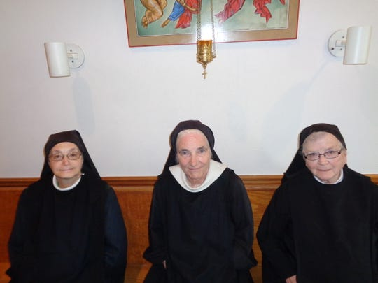 From left, Sister Miriam Walters, Sister Sheila Long and Sister Mary Donald Corcoran prepare to pray in the chapel of Transfiguration Monastery in Windsor. The monastery is celebrating its 40th anniversary this year.