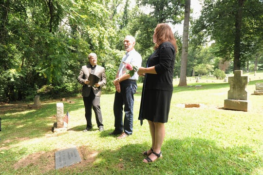 Joe Standaert speaks about the lives of Alice Margaret Dickinson and her sister Helen Louise during a ceremony at Riverside Cemetery on Aug. 1.