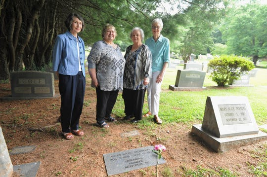 From left to right: Former Montreat College librarian Elizabeth Pearson, Friends of Montreat College Library member Shirley McIntosh, former librarian Sue Diehl and Kay Salmon stand near the grave of Helen Louise Dickinson, whose life was celebrated with a service at Riverside Cemetery on Aug. 1. Dickinson, who lived in Montreat in the early 20th century with her sister Alice Margaret, was librarian at the college for 25 years.