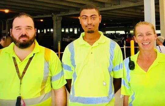 Port Canaveral employees Josh Clayton, Sean Summers and Stephanie Dobson are being credited with helping save a cruise passenger's life.