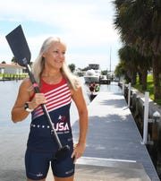 Posing at Oars & Paddles Park in Indian Harbor Beach. Maria Cochran of Melbourne Beach, will be competing in the Dragon Boat world championships in Thailand in August.