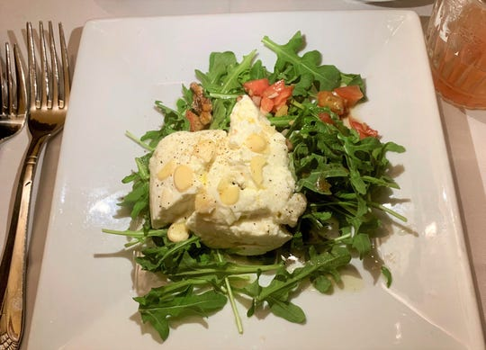 The warm goat cheese at Continental Flambe in downtown Melbourne was delightful.