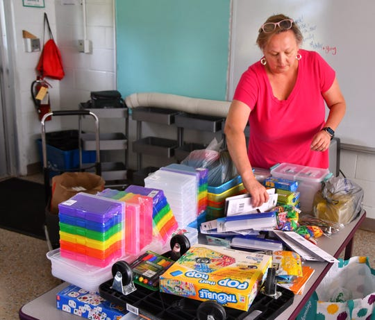 At Freedom 7 School of International Studies in Cocoa Beach, first-grade teacher Millie Curtis sorts the classroom supplies that she purchased with her own money.