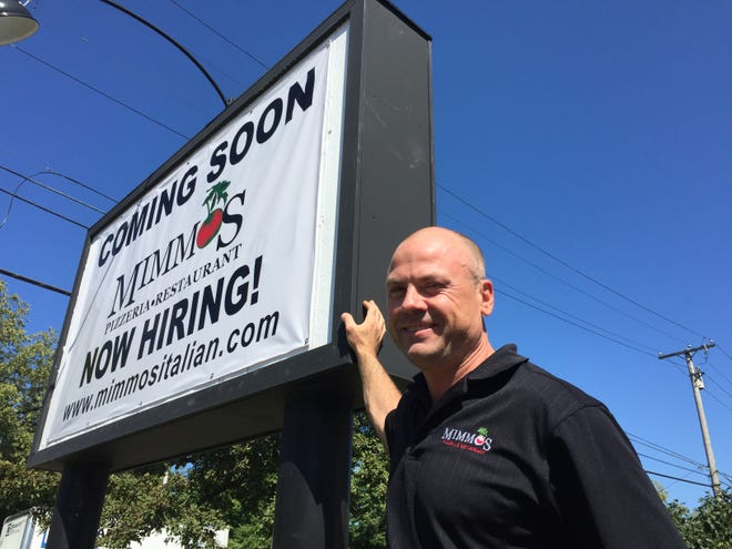 Domenico Spano stands Aug. 5, 2019 in front of the sign outside the former Sorriso Bistro in South Burlington, where Spano plans to open Mimmo's Pizzeria & Restaurant by the end of August.