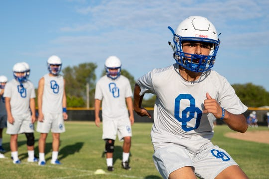 Odem football players run drills during the first day of football practice at Odem High School on Monday Aug. 5, 2019.