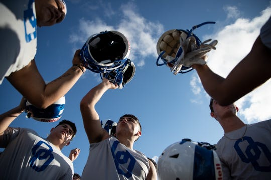 Odem football players huddle during the first day of football practice at Odem High School on Monday Aug. 5, 2019.