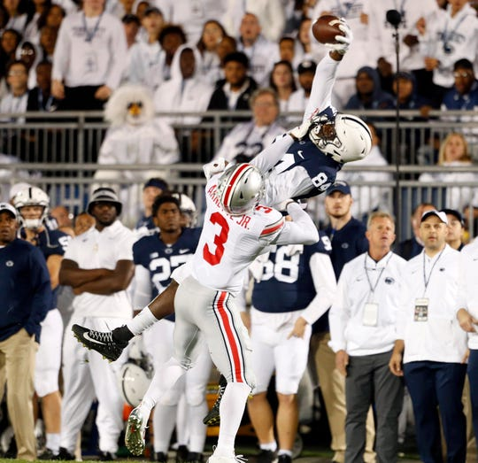 Penn State's Juwan Johnson (84) makes a catch as Ohio State's Damon Arnette (3) defends during the first half of a game in September.