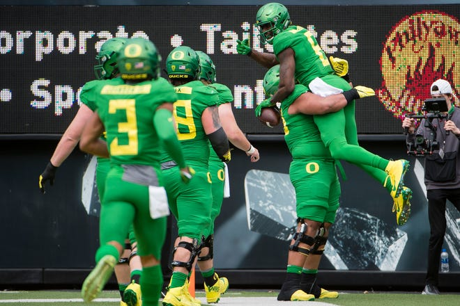 Oregon receiver Juwan Johnson (6) celebrates after scoring a touchdown during the Oregon spring game at Autzen Stadium.