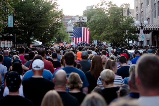 "Governor Mike DeWine speaks during a vigil for the victims of  a mass shooting in the Oregon District of Dayton, Ohio, on Sunday, Aug. 4, 2019. People began chanting ""Do Something"" during DeWine's speech."