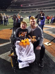Brody Hammons has made friends with Bengals quarterback Andy Dalton. Dalton has got him tickets for games before and Brody's wheelchair displays Dalton's autograph and a Bengal logo.