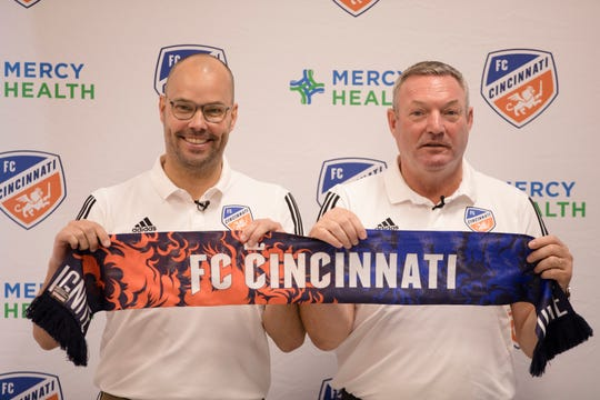 FC Cincinnati head coach Ron Jans, right, joins general manager Gerard Nijkamp  at his first press conference as FC Cincinnati's head coach on Monday, Aug. 5, 2019, in Milford.