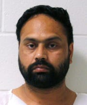 FILE - This booking photo released by the Branford Police Department shows Gurpreet Singh, arrested Tuesday, July 2, 2019, in Branford, Conn. Butler County Jail records show Singh was booked into the jail early Friday, Aug. 2,  after his return from Connecticut. The grand jury indictments were made public nearly eight hours later.  Singh has been indicted on four counts of aggravated murder in the slayings of his wife, her parents and her aunt in an apartment home in southwest Ohio.(Branford Police Department via AP)