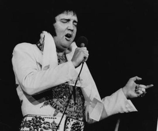 Elvis Presley is shown performing in Providence, R.I. in a file photo from May 23, 1977.