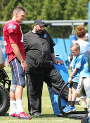 Patriots quarterback Tom Brady talks with Lions coach Matt Patricia and a young fan after the joint practice on Monday, Aug. 5, 2019, in Allen Park.