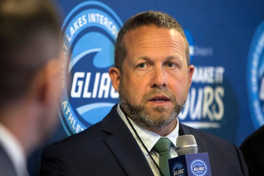 Grand Valley State coach Matt Mitchell is interviewed during the GLIAC media day at the Doubletree Suites by Hilton Hotel, in Detroit, Mich., Monday, Aug 5, 2019.
