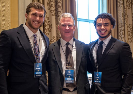 (From left) Northern Michigan's Gabe Baumann, coach Kyle Nystrom and Troy Mayon are photographed during the GLIAC media day at the Doubletree Suites by Hilton Hotel, in Detroit, Mich., Monday, Aug 5, 2019.