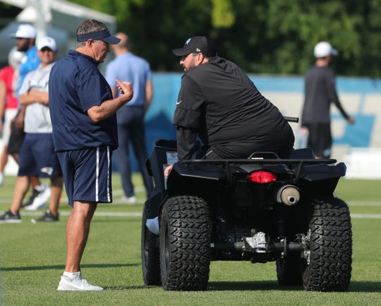 Detroit Lions head coach Matt Patricia and New England Patriots head coach Bill Belichick meet before the joint workout  Monday, August 5, 2019 at the practice facility, in Allen Park Mich.