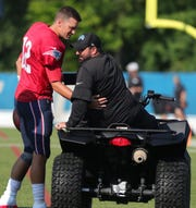 Lions coach Matt Patricia and Patriots quarterback Tom Brady meet before the joint practice on Monday, Aug. 5, 2019, in Allen Park.