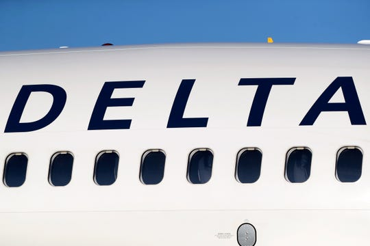Travelers warned to take extra care when trying to book travel. One Michigan family almost lost $300 to a fake travel site impersonating Delta Air Lines. In this June 26, 2019, file photo, the company logo graces the side of a Delta Air Lines jetliner at Denver International Airport in Denver. Delta Air Lines, Inc. reports earnings Wednesday, July 10. (AP Photo/David Zalubowski, File)