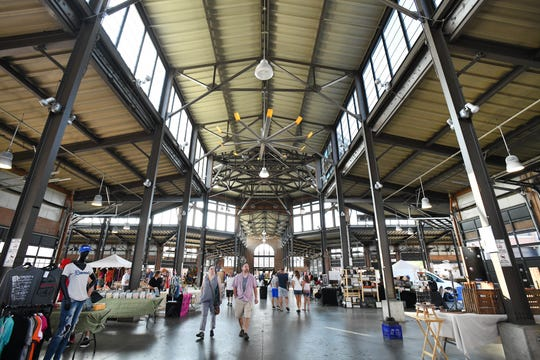 Eastern Market shoppers make their way through Shed 3 on Sunday morning.