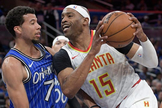 Vince Carter, right, is returning to the Hawks for his 22nd season in the NBA.