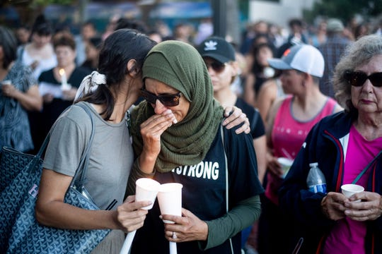 Hina Moheyuddin, left, comforts Noshaba Afzal during a vigil for victims of a Sunday evening shooting that left three people dead at the Gilroy Garlic Festival, Monday, July 29, 2019, in Gilroy, Calif.