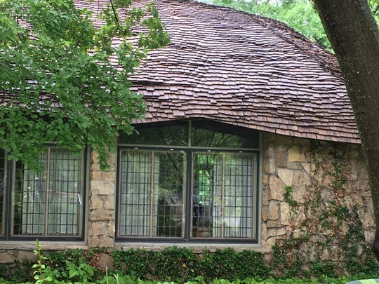 "Undulating rooflines and stone walls characterize most of Earl Young's ""mushroom"" designs."