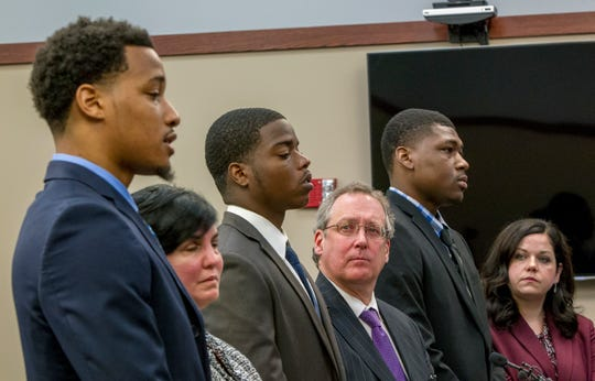 Former Michigan State University football players, from left, Demetric Vance, with defense attorney Mary Chartier, Donnie Corley, with defense attorney John Shea, and Josh King, with defense attorney Shannon Smith, appear for their sentencing in June 2018 at Ingham County 30th Circuit Court in Lansing.