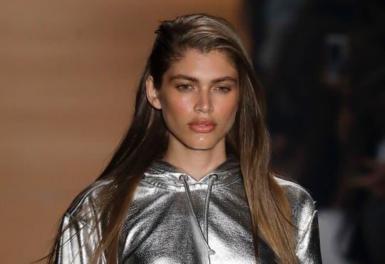 In this March 16, 2017, file photo Brazilian transgender model Valentina Sampaio wears a creation from the Amir Slama collection during Sao Paulo Fashion Week in Sao Paulo, Brazil.