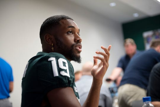 Michigan State's Josh Butler, who is vying for a starting cornerback spot, answers questions during the team's media day at Spartan Stadium on Monday.