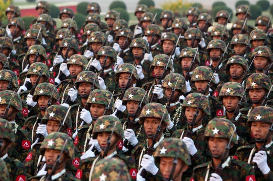 In this March 27, 2019, file photo, Myanmar military officers march during a parade to mark the 74th Armed Forces Day in Naypyitaw, Myanmar.