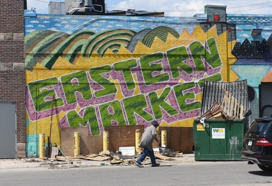 Artists frequently adorn public spaces by painting murals, including at Detroit's Eastern Market.